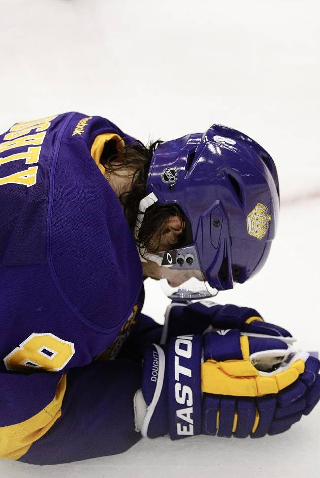 Los Angeles Kings' Drew Doughty lies on the ice after Toronto Maple Leafs' Mason Raymond scored during the third period of an NHL hockey game on Thursday, March 13, 2014, in Los Angeles. The Maple Leafs won 3-2