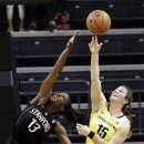 FILE - In this Feb. 1, 2013, file photo, Stanford forward Chiney Ogwumike (13) battles for a rebound with Oregon forward Liz Brenner (15) during the first half of an NCAA college basketball game in Eugene, Ore. Brenner figures she's only in college once, she might as well play the sports she loves. And for the Oregon sophomore, that's volleyball, basketball, softball and track and field although not at once. (AP Photo/Don Ryan, File)