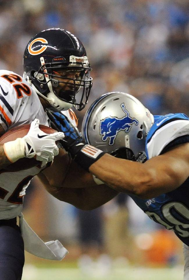 Chicago Bears running back Matt Forte (22) is stopped by Detroit Lions defensive tackle Ndamukong Suh (90) during the third quarter of an NFL football game at Ford Field in Detroit, Sunday, Sept. 29, 2013