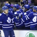 Toronto Maple Leafs' James van Riemsdyk (21) celebrates his goal with teammates against the Colorado Avalanche during the first period of an NHL hockey game Tuesday, Oct. 14, 2014, in Toronto The Associated Press