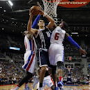 Oklahoma City Thunder center Steven Adams (12) drives between Detroit Pistons forward Greg Monroe, left, and forward Josh Smith (6) in the second half of an NBA basketball game in Detroit, Friday, Nov. 8, 2013 The Associated Press