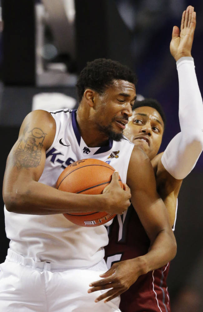 Kansas State guard Shane Southwell (1) rebounds against Troy forward Kevin Thomas, back, during the second half of an NCAA college basketball game at Bramlage Coliseum in Manhattan, Kan., Sunday, Dec. 15, 2013. Kansas State defeated Troy 72-43