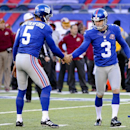New York Giants kicker Josh Brown (3) is congratulated by New York Giants punter Steve Weatherford (5) after kicking a field goal against the Washington Redskins during the third quarter of an NFL football game, Sunday, Dec. 14, 2014, in East Rutherford,