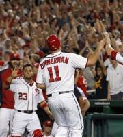 Washington Nationals' Ryan Zimmerman (11) celebrates with Danny Espinosa (8) after Zimmerman scored the winning run on a wild pitch from New York Mets relief pitcher Pedro Beato during the 10th inning of a baseball game Tuesday, July 17, 2012, in Washington. The Nationals won 5-4. (AP Photo/Alex Brandon)
