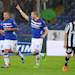 Sampdoria's Lorenzo De Silvestri, center, celebrates after scoring during a Serie A soccer match between Sampdoria and Juventus at the Genoa Luigi Ferraris stadium, Italy, Saturday, May 18, 2013