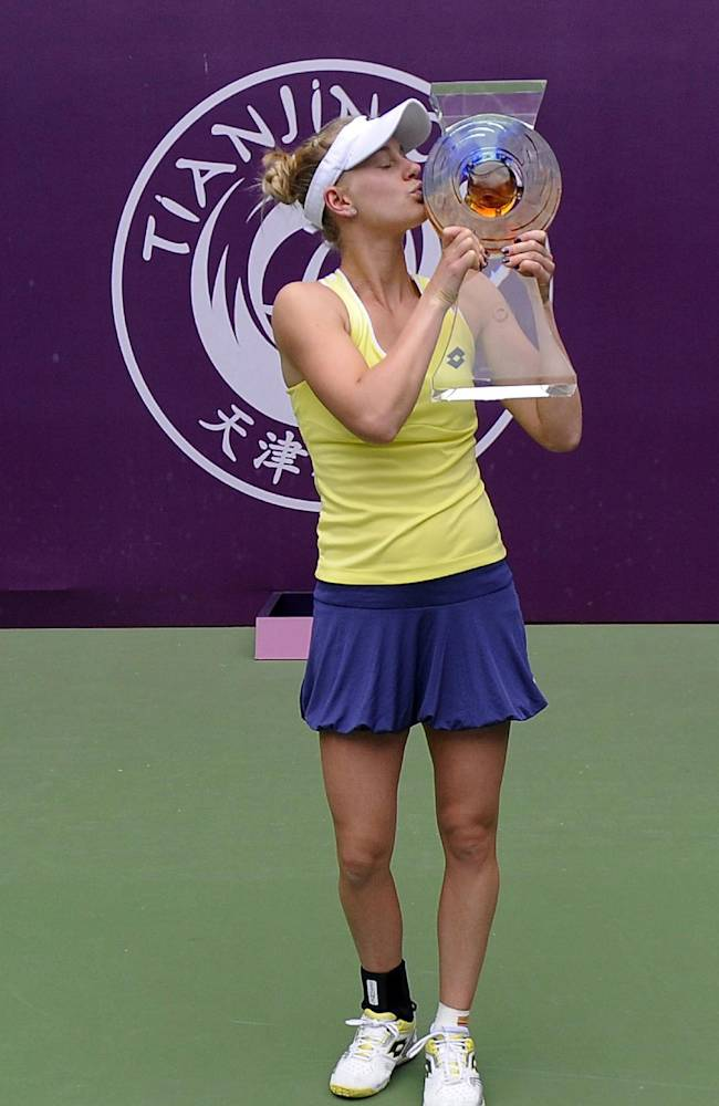 Alison Riske of the United States kisses her trophy after defeating Belinda Bencic of Switzerland for the women's singles final at the Tianjin Open tennis tournament in Tianjin, northern China, Sunday, Oct. 12, 2014. Riske won by 6-3, 6-4 to get her first WTA title. (AP Photo)