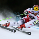 Marcel Hirscher, of Austria, powers past a gate on his way to clock the fastest time during the first run of an alpine ski, men's World Cup giant slalom race, in Alta Badia, Italy, Sunday, Dec. 21, 2014. (AP Photo/Marco Trovati)