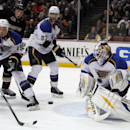 St. Louis Blues goalie Brian Elliott, right, stops a shot as defensemen Jay Bouwmeester (19) and Alex Pietrangelo (27) help, with Anaheim Ducks left wing Matt Beleskey, second from left, on the attack during the second period of an NHL hockey game Friday,