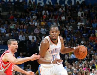 OKLAHOMA CITY, OK - MARCH 11: Kevin Durant #35 of the Oklahoma City Thunder handles the ball against the Houston Rockets during an NBA game on March 11, 2014 at the Chesapeake Energy Arena in Oklahoma City, Oklahoma. (Photo by Layne Murdoch Jr./NBAE via Getty Images)
