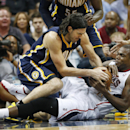 CORRECTS TO THURSDAY NOT WEDNESDAY - Indiana Pacers forward Luis Scola, left, and Atlanta Hawks forward Paul Millsap fight for a loose ball in the first half of Game 3 of an NBA basketball first-round playoff series on Thursday, April 24, 2014, in Atlanta