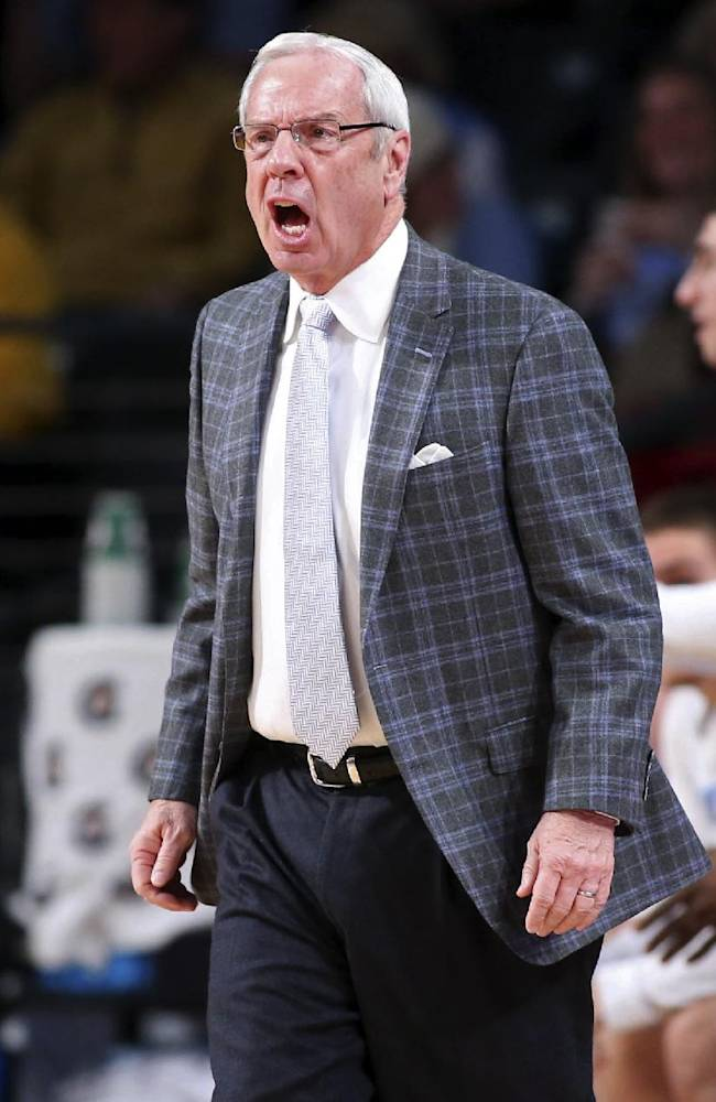 North Carolina coach Roy Williams argues a call in the first half of an NCAA college basketball game against Georgia Tech, Wednesday, Jan. 29, 2014, in Atlanta