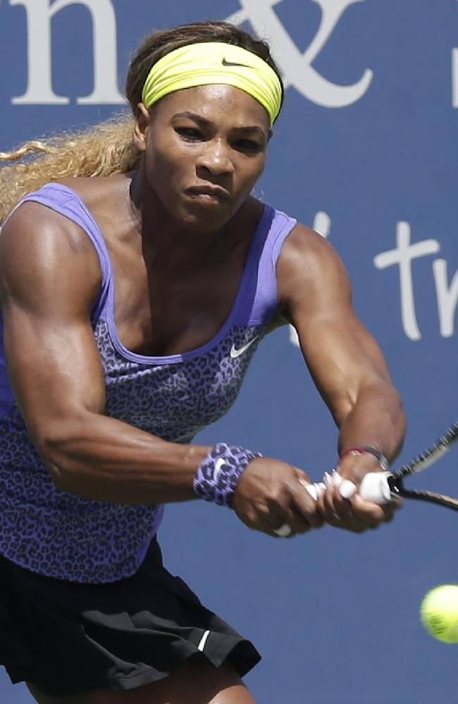 Serena Williams hits a backhand against Samatha Stosur, from Australia, during a match at the Western & Southern Open tennis tournament, Wednesday, Aug. 13, 2014, in Mason, Ohio