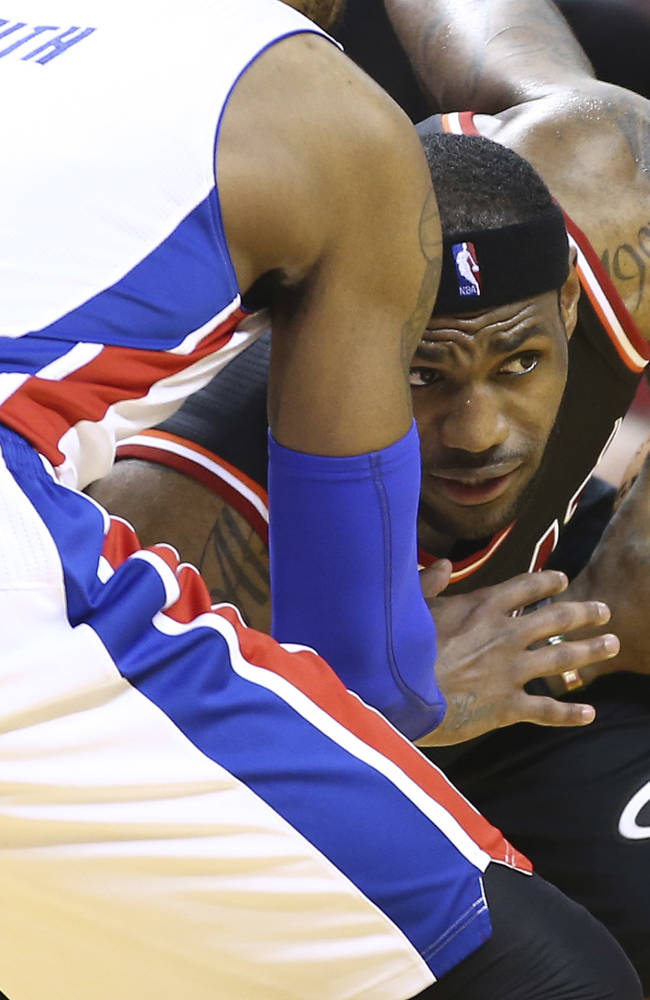 As Detroit Pistons' Josh Smith (6) defends as Miami Heat's LeBron James (6) looks to pass the ball during the second half of an NBA basketball game in Miami, Monday, Feb. 3, 2014. The Heat won 102-96