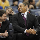 Golden State Warriors head coach Mark Jackson, right, and assistant coach Darren Erman share a lighthearted moment while playing against the Memphis Grizzlies during an NBA basketball game Saturday, Dec. 7, 2013, in Memphis, Tenn. (AP Photo/Lance Murphey)