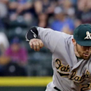 Cano has 3 hits, A's make 4 errors in Mariners' 7-2 win The Associated Press