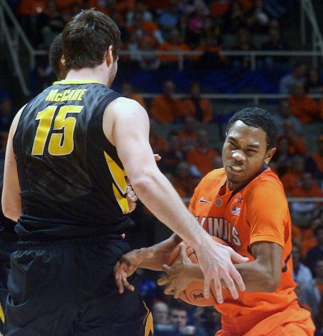 Illinois' Jaylon Tate (1) tries to keep the ball away from Iowa's Zach McCabe (15) during an NCAA college basketball game in Champaign, Ill., Saturday, Feb. 1, 2014