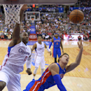 Detroit Pistons forward Jonas Jerebko, right, of Sweden, puts up a shot as Los Angeles Clippers forward Glen Davis defends during the first half of an NBA basketball game, Saturday, March 22, 2014, in Los Angeles The Associated Press