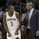 Cleveland Cavaliers' Dion Waiters smiles while listening to coach Mike Brown during the fourth quarter of an NBA basketball game against the Sacramento Kings on Tuesday, Feb. 11, 2014, in Cleveland. Waiters scored 20 points in the Cavaliers' 109-99 win Th