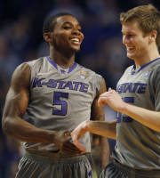 Kansas State guards Jevon Thomas (5) and Will Spradling (55) celebrate following an NCAA college basketball game against Oklahoma State in Manhattan, Kan., Saturday, Jan. 4, 2014. Kansas State defeated Oklahoma State 74-71. (AP Photo/Orlin Wagner)