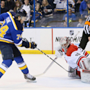 St. Louis Blues right wing T.J. Oshie lifts the puck over the glove of Carolina Hurricanes goaltender Cam Ward to score the lone goal in a shootout during an NHL hockey game, Saturday, Jan. 10, 2015, in St. Louis The Associated Press