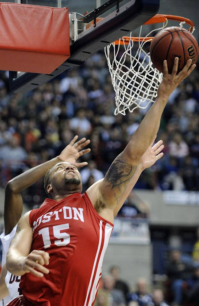 Boston University's Dom Morris (15) drives to the basket during the first half of an NCAA college basketball game against Connecticut in Storrs, Conn., on Sunday, Nov. 17, 2013