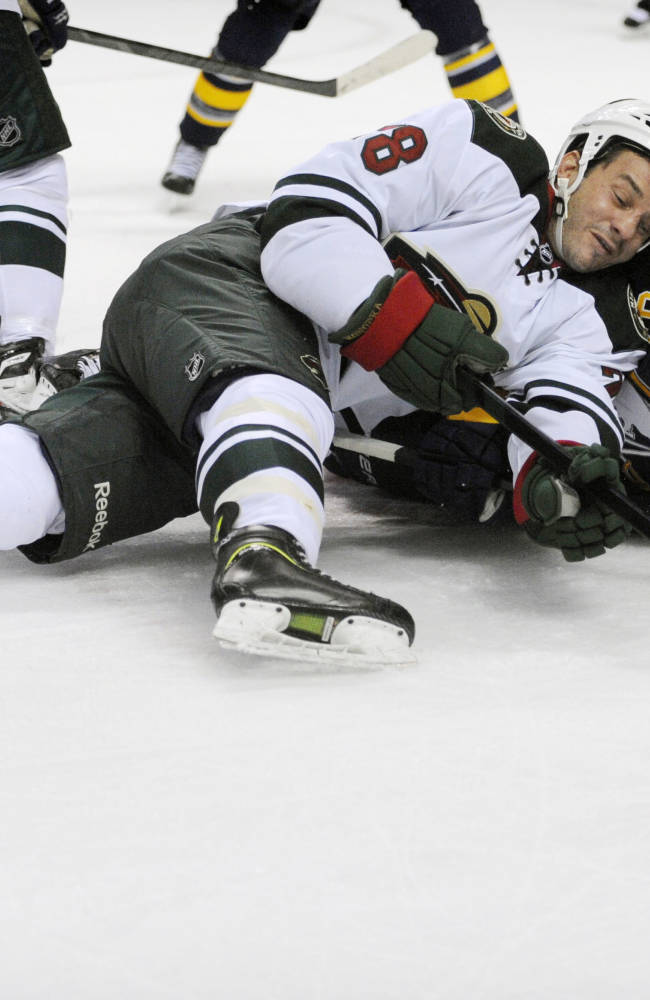 Minnesota Wild center Zenon Konopka (28) battles for the puck with Buffalo Sabres center Tyler Ennis (63) on a face off  during the second period of an NHL hockey game in Buffalo, N.Y., Monday, Oct. 14, 2013