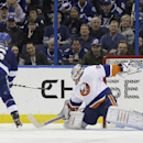 Tampa Bay Lightning defenseman Sami Salo (6), of Finland, scores against New York Islanders goalie Evgeni Nabokov (20), of Kazakhstan, in the shootout of an NHL hockey game Thursday, March 27, 2014, in Tampa, Fla. The Lightning won 3-2 The Associated Pres