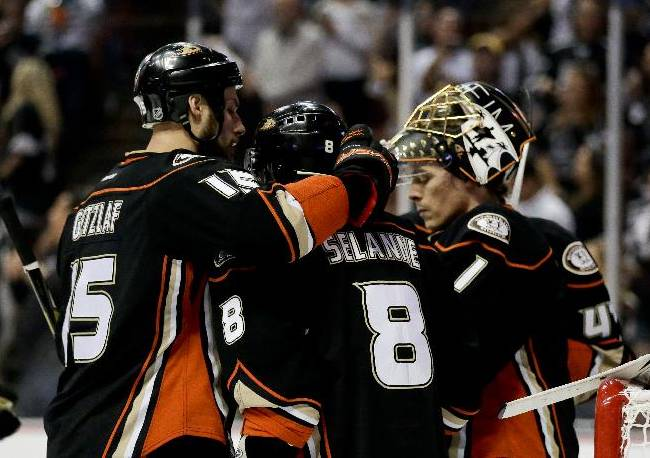 Anaheim Ducks right wing Teemu Selanne, middle, is greeted by center Ryan Getzlaf, left, and goalie Jonas Hiller after their loss against the Los Angeles Kings during Game 7 of an NHL hockey second-round Stanley Cup playoff series in Anaheim, Calif., Friday, May 16, 2014