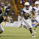 Washington running back Lavon Coleman (22) sprints away from Hawaii linebacker Tevita Lataimua (52) and runs for a first down that seals the game late in the fourth quarter of an NCAA college football game, Saturday, Aug. 30, 2014, in Honolulu. Washington