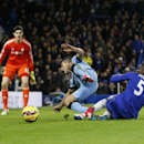 Chelsea's Kurt Zouma, right, and Manchester City's Sergio Aguero fall during the English Premier League soccer match between Chelsea and Manchester City at Stamford Bridge stadium in London, Saturday, Jan. 31, 2015