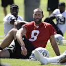 Oakland Raiders quarterback Matt Schaub rests after stretching during NFL football training camp Friday, July 25, 2014, in Napa, Calif. In the background at right is wide receiver James Jones. (AP Photo) The Associated Press