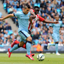 Manchester City's Sergio Aguero, left, and Southampton's Victor Wanyama battle for the ball during the English Premier League soccer match at the Etihad Stadium, Manchester, England, Sunday May 24, 2015. (Martin Rickett/PA via AP) UNITED KINGDOM O