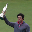 Rory McIlroy of Northern Ireland holds up the Claret Jug trophy after winning the British Open Golf championship at the Royal Liverpool golf club, Hoylake, England, Sunday July 20, 2014. (AP Photo/Jon Super)