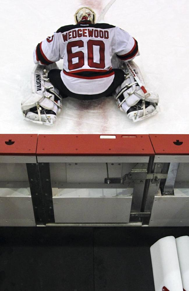 Goalie Scott Wedgewood stretches during the Devils' rookies NHL hockey camp,, Tuesday, July 15, 2014, in Newark, N.J