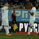 Dynamo Moscow's Aleksandr Kokorin, left, celebrates with teammate Christian Noboa after scoring the opening goal against Estoril during the Europa League group E soccer match between Dynamo Moscow and Estoril at the Antonio Coimbra Da Mota stadium, in Est