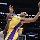 Los Angeles Lakers' Xavier Henry, center, passes the ball as he is defended by Los Angeles Clippers' Chris Paul during the first half of an NBA basketball game on Thursday, March 6, 2014, in Los Angeles The Associated Press