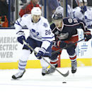 Columbus Blue Jackets' Adam Cracknell (32) chases Toronto Maple Leafs' Daniel Winnik (26) in the first period of an NHL hockey game, Friday, Oct. 31, 2014, in Columbus, Ohio The Associated Press