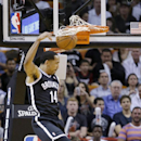 Brooklyn Nets guard Shaun Livingston dunks the ball during the first half of an NBA basketball game against the Miami Heat, Tuesday, April 8, 2014 in Miami The Associated Press