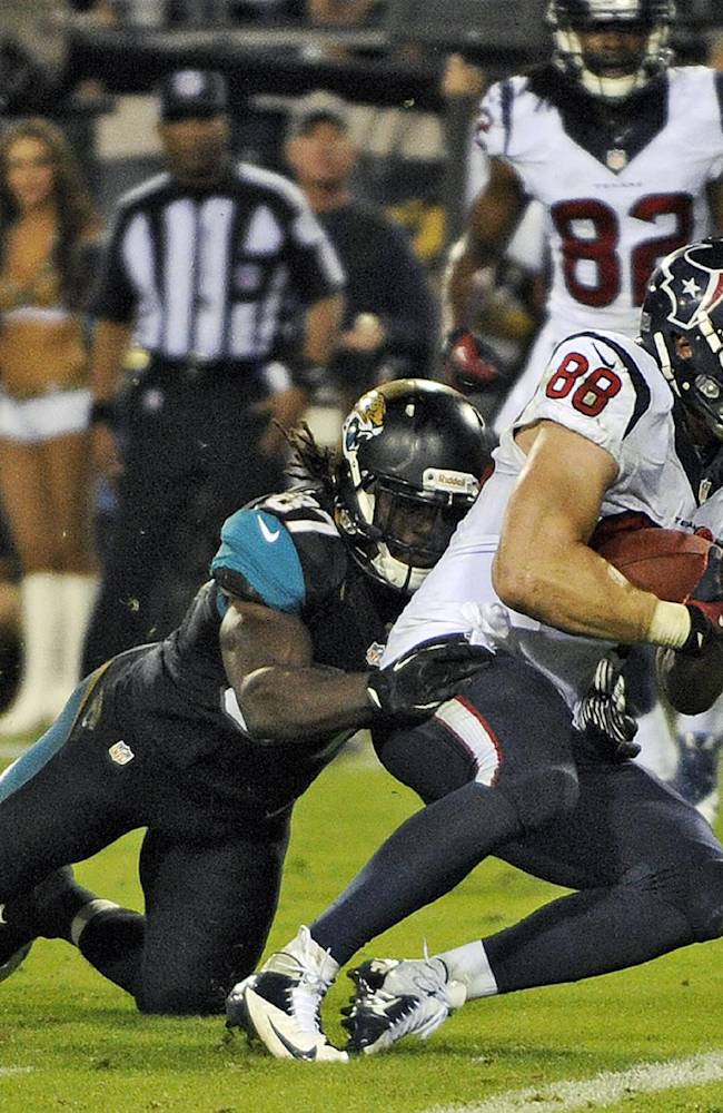 Houston Texans tight end Garrett Graham (88) scores after getting past Jacksonville Jaguars strong safety Johnathan Cyprien (37) on five yard touchdown pass during the third quarter of an NFL football game Thursday, Dec. 5, 2013, in Jacksonville, Fla