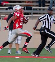 New Mexico's Carlos Wiggins returns a kick off for a 100-yard touchdown against New Mexico State in the first half of an NCAA college football game on Saturday, Oct. 5, 2013, in Albuquerque, N.M. (AP Photo/Eric Draper)
