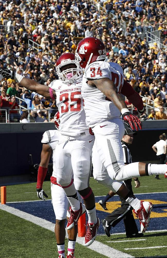 Washington State running back Marcus Mason (35) celebrates with teammate Teondray Caldwell (34) after Mason scored a touchdown against California during the first half of an NCAA college football game in Berkeley, Calif., Saturday, Oct. 5, 2013