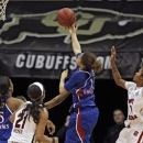 Kansas guard Monica Engelman (13) puts up a shot as South Carolina forward Ashley Bruner (21) and South Carolina guard Sancheon White (20) defend during the second half of a second-round game in the women's NCAA college basketball tournament on Monday, March 25, 2013, in Boulder. Colo. (AP Photo/ Ed Andrieski)