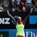 Serena Williams of the U.S. celebrates after defeating Garbine Muguruza of Spain during their fourth round match at the Australian Open tennis championship in Melbourne, Australia, Monday, Jan. 26, 2015. (AP Photo/Rob Griffith)