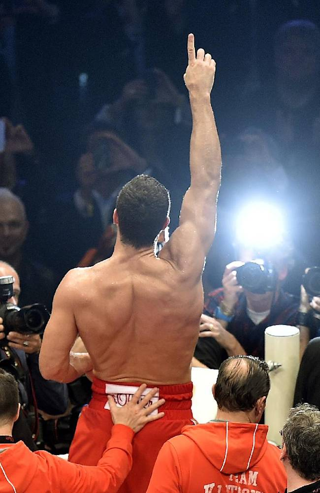 World boxing champion Wladimir Klitschko gestures to supporters after defeating Samoan-born Australian Alex Leapai following their IBF, IBO, WBO and WBA heavyweight title bout in Oberhausen, Germany, Saturday, April 26, 2014. Klitschko won the fight by technical knock out in the fifth round