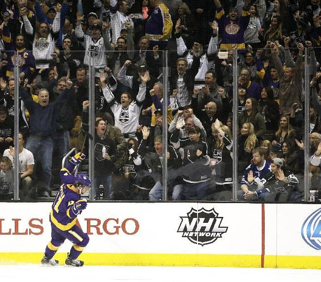 Fans cheer as Los Angeles Kings' Anze Kopitar, of Slovenia, celebrates his goal against the Toronto Maple Leafs during the first period of an NHL hockey game on Thursday, March 13, 2014, in Los Angeles