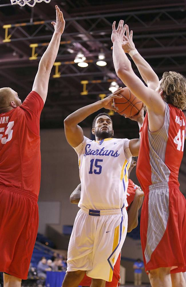 San Jose State forward Chris Cunningham (15) drives to the basket between New Mexico center Alex Kirk (53) and forward Cameron Bairstow (41) during the second half of an NCAA college basketball game, Saturday, Jan. 11, 2014, in San Jose, Calif. New Mexico won 69-65