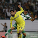 Chelsea's Mohamed Salah, foreground, is challenged by Sporting's Jonathan Silva, during a Champions League, Group G soccer match between Sporting and Chelsea, in Lisbon, Tuesday, Sept. 30, 2014