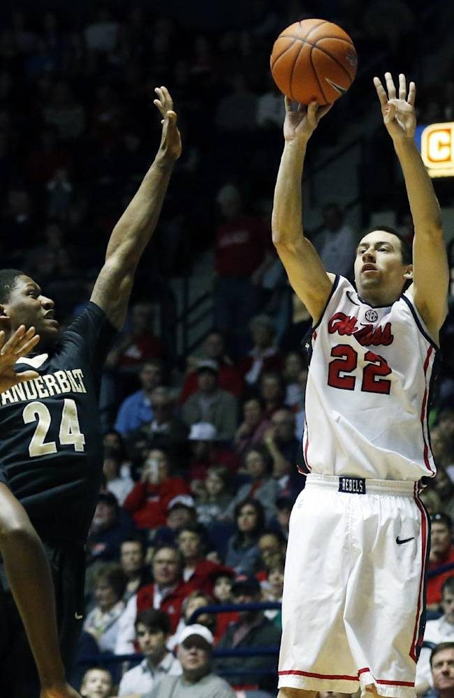 Mississippi guard Marshall Henderson (22) attempts a 3-point basket past the defense of Vanderbilt guard Dai-Jon Parker (24) in the first half of an NCAA college basketball game in Oxford, Miss., Saturday, March 8, 2014. Mississippi won 65-62