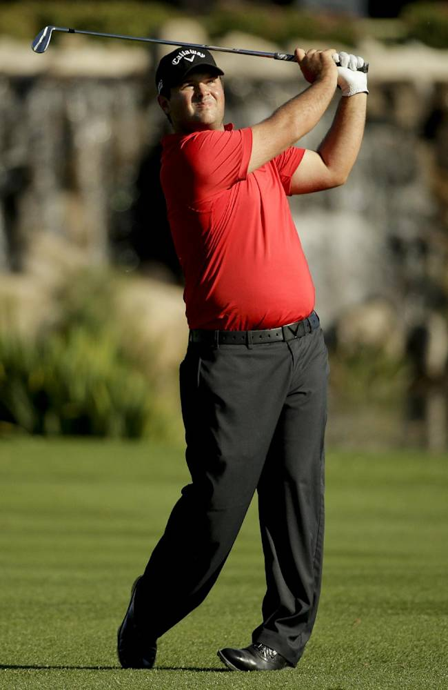 Patrick Reed watches his shot to the 18th green during the second round of the Humana Challenge golf tournament at La Quinta Country Club on Friday, Jan. 17, 2014, in La Quinta, Calif