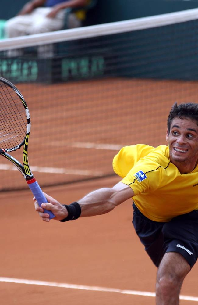 Rogerio Dutra Silva, of Brazil, returns to Emilio Gomez, of Ecuador, at a Davis Cup tennis match in Guayaquil, Ecuador, Sunday, April 6, 2014